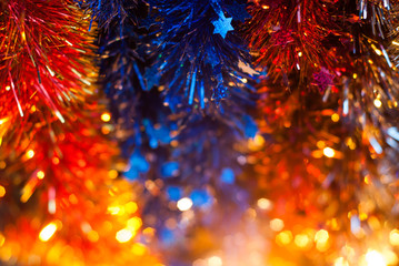 New year tinsel colored yellow, blue, red, selective focus,