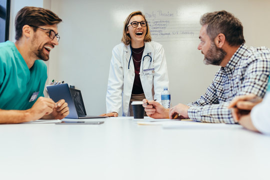 Healthcare professionals smiling during meeting
