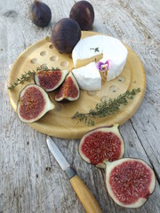 Cheeseboard. Brie cheese and ripe figs. Vertical.