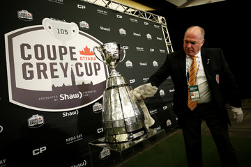 Tom Chalmers of the Canadian Football Hall of Fame polishes the Grey Cup during the media day in Ottawa