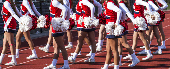 High school cheerladers during a football game
