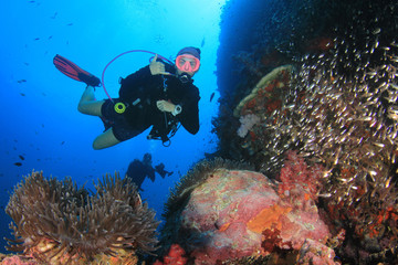 Scuba diver. Young woman scuba diving on coral reef