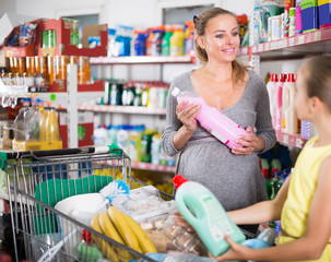 child with  mom shows bought household chemicals