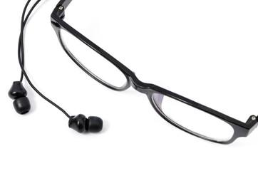 Black earphones and eyeglasses