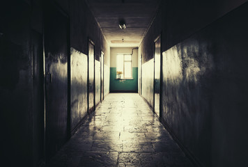 Dark long corridor with doors