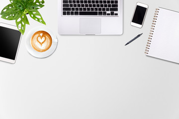 Modern workspace with laptop tablet, smartphone and coffee cup copy space on white wood table background. Top view. Flat lay style.