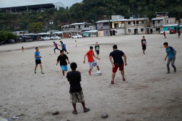 Youths play soccer ahead of the November 26 presidential election in Tegucigalpa