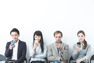 Group of people using smart phones.