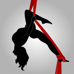 silhouette of gymnast on ribbons