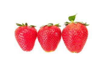 Three fresh strawberry in a row