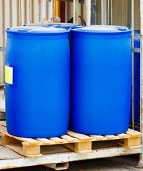 Two blue scratched barrels