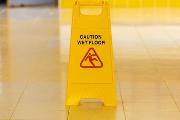 Yellow wet floor caution sign
