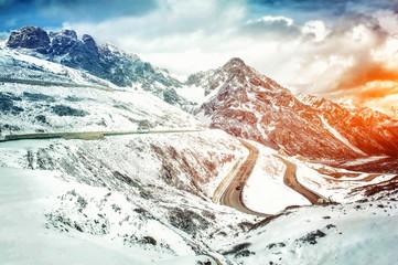 Winding mountain road in winter