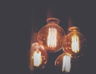 Vintage glowing light bulb background