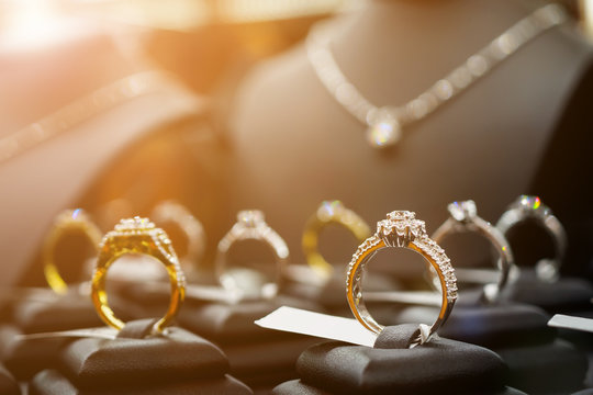 Jewelry diamond rings and necklaces show in luxury retail store window display