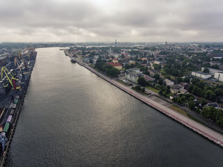 Aerial view over river Venta with a view to Ventspils panorama in Latvia. During summer time.