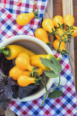 Yellow hot pepper and yellow tomatoes with purple basil