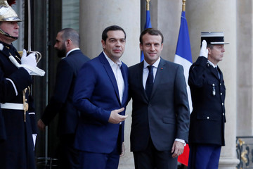 French President Emmanuel Macron welcomes Greek Prime Minister Alexis Tsipras at the Elysee Palace in Paris