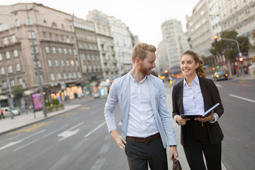 Businesspeople commuting and walking in city