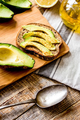 making sandwiches with avocado healthy organic food top view