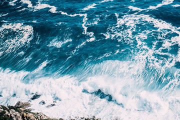 Bright blue ocean and waves from above