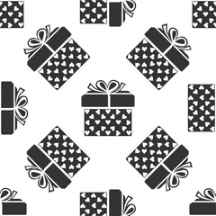 Gift box and heart icon seamless pattern on white background. Packaging Valentine's Day. Beautiful festive box tied with ribbon and bow on top. Flat design. Vector Illustration