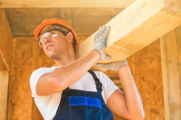 Man building wooden house