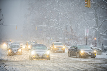 A winter snowstorm brings traffic to a slow crawl on Fifth Avenue.