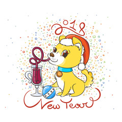 Golden dog with the cup of mulled wine and a cake. New Year symbol of 2018.