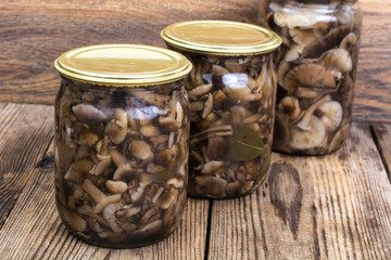 Home made cans. Glass jars with pickled mushrooms