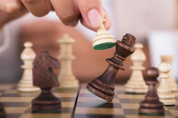 Hand Playing Chess And Falling King