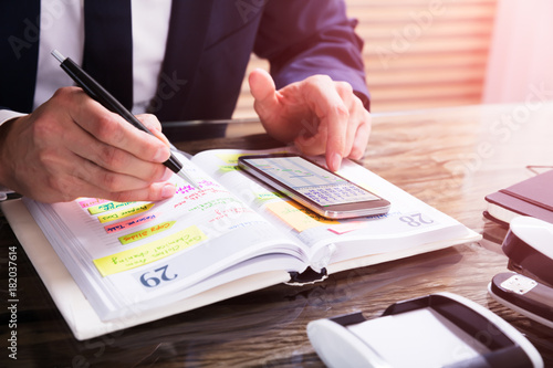 businessperson using mobile phone stock photo and royalty free