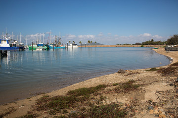 General view of Bowen Harbour, Northern Whitsundays, Queensland. Marina with pleasure boats and fishing trawlers.