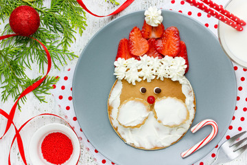 Santa Claus pancakes with whipped cream and strawberries