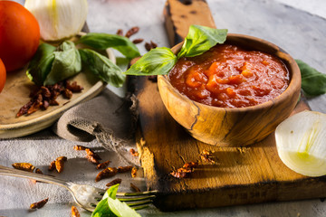 Sauce arrabiata made with tomato, onion and chili pepper spicy.