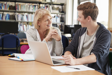 College Student Has Individual Tuition From Teacher In Library