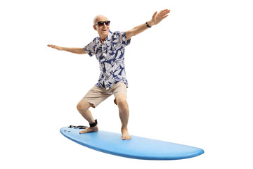 Joyful elderly man surfing