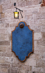 restaurant exterior in Provence style, signboard with lantern.