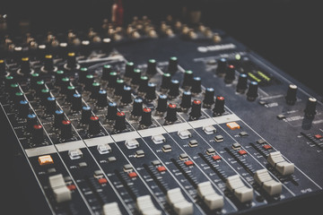 Sound operator console or sound mixer control panel of DJ for music mixing and recording on studio or party
