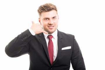 Handsome business man showing contact gesture
