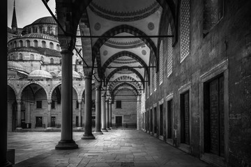 The Sultanahmet Mosque the Blue Mosque alley view from inside in black and white  in Istanbul, Turkey