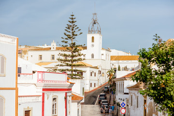 Cityscape view on the old town with beautiful white houses and church in Albufeira city on the south of Portugal