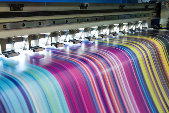 Large inkjet printer working multicolor on vinyl banner