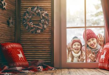 family on snowy winter walk