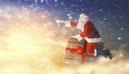 Santa Claus flying on gift box