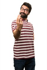 Man with glasses doing coming gesture