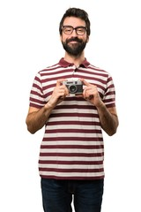 Happy Man with glasses holding a camera