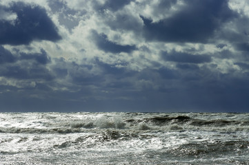 Poster Zee / Oceaan Storm on the sea wave against a cloud background in the sky landscape