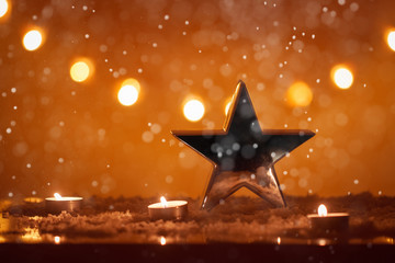 Christmas background with big silver star, candles, snow, bokeh lights, snowing, x-mas