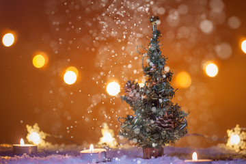 Chirstmas background with Christmas tree, snow, candles, lights, bokeh lights, snowing